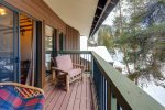 Private balcony with forested view and comfortable seating