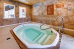 Common area indoor hot tub available in clubhouse that is located 25 yards from the condo