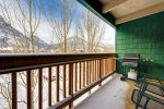 Private balcony off living room with views of Mount Royal and Peak 1.