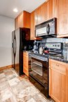 Beautifully updated kitchen with oven, dishwasher, microwave, and coffee maker