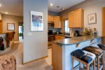 The condo has a fully equipped kitchen that has granite counter tops and stainless steel appliances