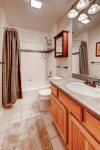 Level 3 - Full bathroom with tub and shower shared by the guest room and bunk room