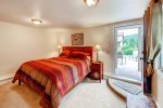 Level 3 guest room, 2nd bedroom on 3rd level with king bed. Walk out to private hot tub.