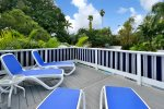 2nd story topless sunbathing deck over looking pool and gardens