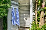 Outdoor shower at rear of Family Pool in the midst of orchids and gardensd