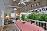 Large covered veranda with seating for 10 to enjoy meals, ceiling fans