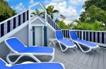 4 loungers to sun on that is completely private, surrounded by awnings