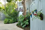 Enter thru the gate at 912-914 Center Street into a tropical garden setting