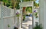 Across the street is the gated entrance to the heated Adult`s Only pool
