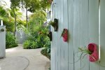 A gated compound, walk down the tropical, orchid laden path to the private entrance