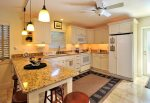 Fully equipped kitchen w/dishwasher, microwave, glass top stove, breakfast bar