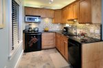 Granite counter tops, under-counter frig/freezer, microwave, 2 burner stove, dishwasher, coffee maker, toaster, blender