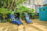 Tropical backyard with deck