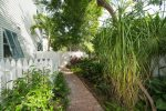 Pool and lush private gardens surround Windsor Townhome 6