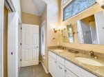 Master bathroom has separate tub and shower and also offers a double vanity at 30 Heath Drive