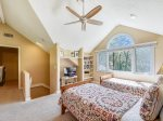 The loft bedroom upstairs offers two twin beds and a private bathroom at 30 Heath Drive