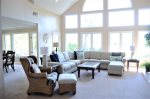 Spacious living room with floor to ceiling windows looking out onto the Fazio Golf Course at 30 Heath Drive
