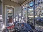 Screened Porch Leads to Wrap Around Deck with BBQ Grill at 102 Baynard Cove