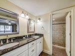 Master Bathroom Features a Double Vanity and Large Walk In Shower at 15 Fazio