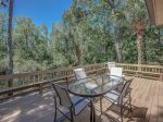 Outdoor Dining Table with Lagoon Views at 28 Shell Ring