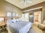 Guest Bedroom with TV and Bathroom at 9 Beach Lagoon