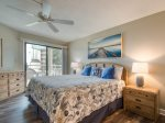 Master Bedroom with King Bed and Private Balcony Access at 1204 Villamare