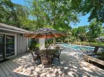 Large Pool Deck Area with Dining Table and BBQ Grill at 13 St Andrews