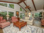 Open Living Room with Vaulted Ceilings Lagoon Views at 13 St Andrews