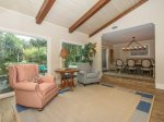 Sitting Area off Living Room Offers Views of the Pool and Lagoon at 13 St Andrews