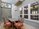 Covered Side Deck with Dining Table and Access to Pool Level at 29 Sandpiper