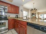 Updated Kitchen with Stainless Steel Appliances at 1873 Beachside Tennis