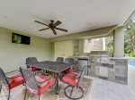Downstairs Covered Patio Located off Pool Deck with BBQ Grill and Dining Table at 159 Mooring Buoy