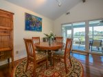 Small Dining Area with Seating for Four Offers Water Views at 44 Lands End