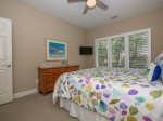 Guest Bedroom with TV and Access to Shared Bath at 22 Shell Ring