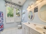 Shared Hall Bath with Double Vanity and Shower/Tub Combo at 1 Hickory Lane