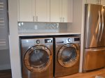 Kitchen with Full Size Front Loading Washer and Dryer at 2418 Villamare