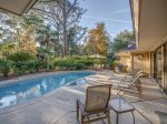 Pool Deck Area with Lounge Chairs, Dining Area and BBQ Grill at 8 Wood Ibis