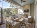 Off Living Room and Dining Area is a Beautiful Screened Porch Overlooking Pool and Lagoon at 24 Rum Row