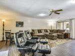 Second Living Area with Plenty of Comfortable Seating and Large Flat Screen TV at 15 East Garrison