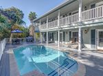 Spacious Pool Deck with Multiple Dining Table and Outdoor Grill at 4 Driftwood