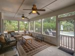 Screened Porch off Kitchen Overlooks Pool at 46 Lagoon Road in Forest Beach