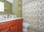 Guest Bathroom with Shower/Tub Combo at 220 Evian