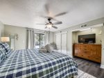 Master Bedroom with King Bed and Patio Access at 606 Queens Grant