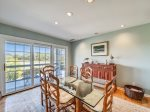 Dining Area with Seating for Six Offers Views of Braddock Cove at 32 Lands End