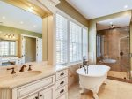 Private Master Bathroom with His and Hers Walk in Closests at 7 Armada