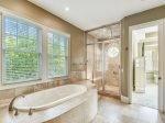 Master Bath offers Separate Tub and Shower at 3 Iron Clad
