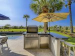 Grilling Area with Dining Table by Pool at 10 Sea Hawk Lane