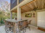 Outdoor Kitchen and Dining Area at 216 Cordillo Parkway