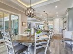 Kitchen and Dining Area with Seating for Six Overlook Pool and Golf Course at 28 Stoney Creek