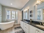 Master Bathroom with Double Vanity and Separate Soaking Tub at 29 Pelican